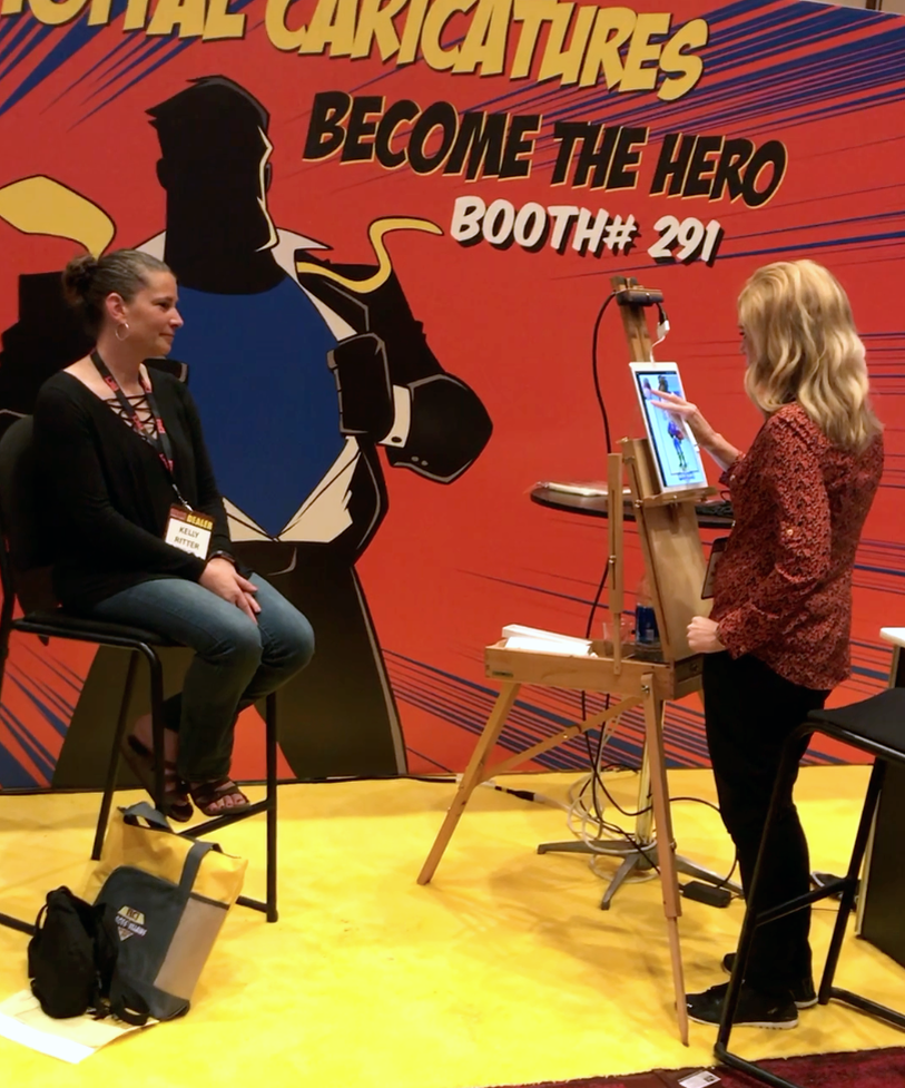 Rachel murphy drawing digital super hero caricatures for a trade show in New York